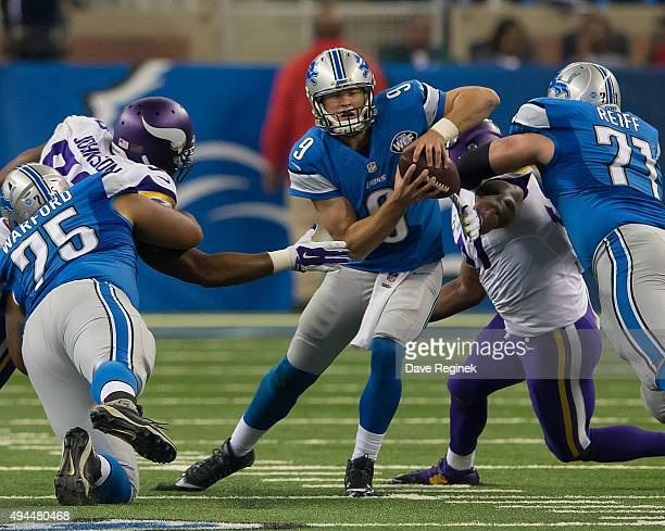 Matthew Stafford of the Detroit Lions tries to avoid getting sacked during an NFL game against the Minnesota Vikings at Ford Field on October 25 2015...