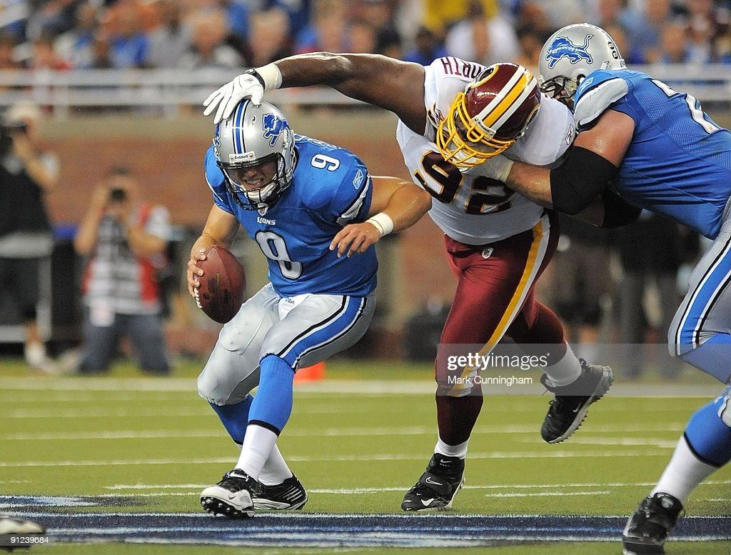 Matthew Stafford #9 of the Detroit Lions tries to elude Albert Haynesworth #92 of the Washington Redskins at Ford Field on September 27, 2009 in Detroit, Michigan. The Lions defeated the Redskins 19-14.