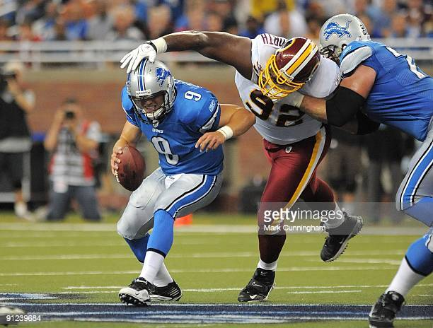 Matthew Stafford of the Detroit Lions tries to elude Albert Haynesworth of the Washington Redskins at Ford Field on September 27 2009 in Detroit...