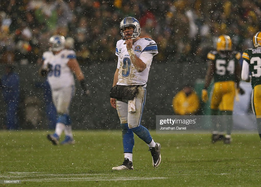 Matthew Stafford #9 of the Detroit Lions walks off of the field after fumbling the ball that resulted in a Green Bay Packer touchdown at Lambeau Field on December 9, 2012 in Green Bay, Wisconsin.