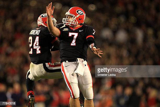 Matthew Stafford of the Georgia Bulldogs celebrates with teammate Knowshon Moreno after a touchdown against the Auburn Tigers during their game at...
