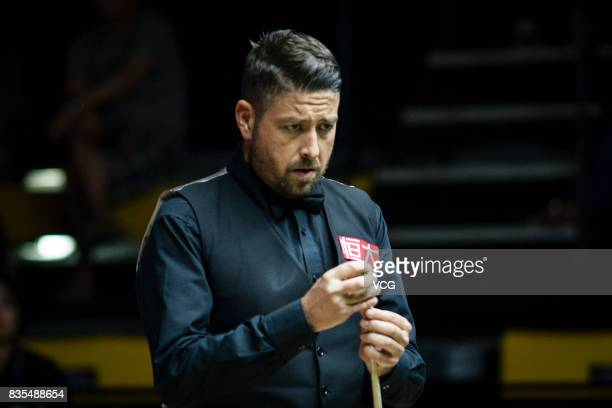 Matthew Stevens of Wales chalks the cue during his third round match against Li Hang of China on day four of Evergrande 2017 World Snooker China...