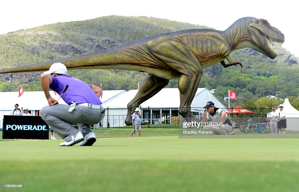 Matthew Stieger lines up a putt on the ninth hole as a large model T-Rex dinosaur can be seen in the background during round one of the Australian PGA at the Palmer Coolum Resort on December 13, 2012 in Sunshine Coast, Australia.