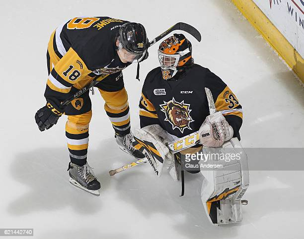 Matthew Strome and Kaden Fulcher of the Hamilton Bulldogs chat during the warmup prior to play against the London Knights in an OHL game at Budweiser...