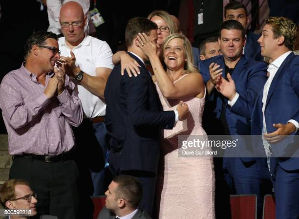 Matthew Strome celebrates with his family after being selected 106th overall by the Philadelphia Flyers during the 2017 NHL Draft at United Center on...