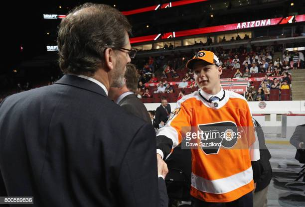 Matthew Strome meets general manager Ron Hextall after being selected 106th overall by the Philadelphia Flyers during the 2017 NHL Draft at United...