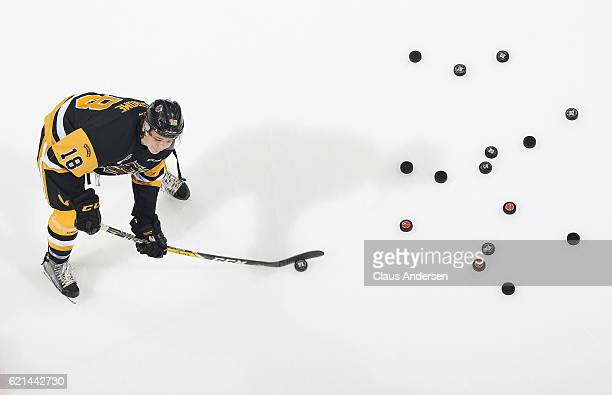 Matthew Strome of the Hamilton Bulldogs fires shots during the warmup prior to play against the London Knights in an OHL game at Budweiser Gardens on...
