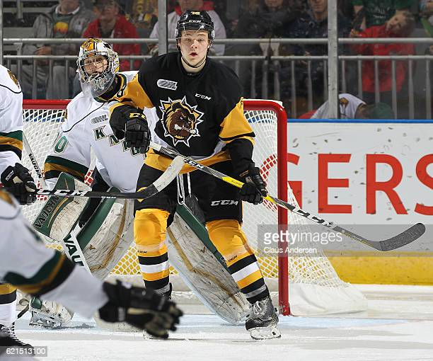 Matthew Strome of the Hamilton Bulldogs screens Emanuel Vella of the London Knights during an OHL game at Budweiser Gardens on November 6 2016 in...