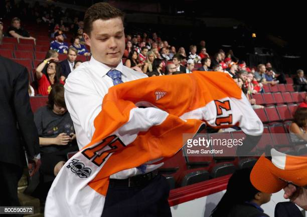 Matthew Strome puts on his jersey after being selected 106th overall by the Philadelphia Flyers during the 2017 NHL Draft at United Center on June 24...