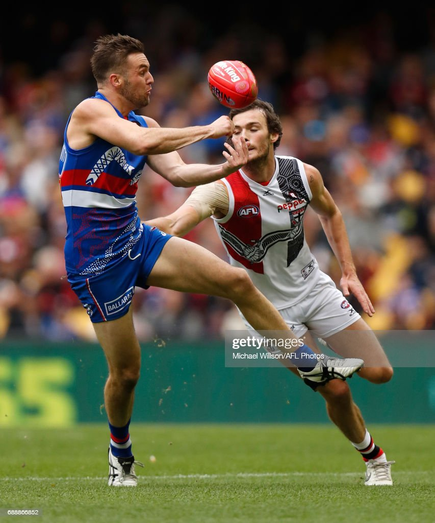 Matthew Suckling of the Bulldogs and Dylan Roberton of the Saints in action during the 2017 AFL round 10 match between the Western Bulldogs and the St Kilda Saints at Etihad Stadium on May 27, 2017 in Melbourne, Australia.
