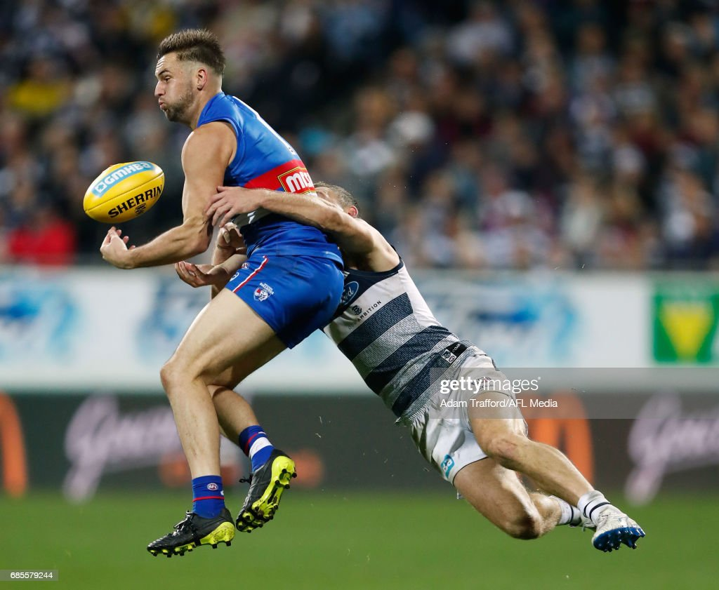 Matthew Suckling of the Bulldogs and Joel Selwood of the Cats compete for the ball during the 2017 AFL round 09 match between the Geelong Cats and the Western Bulldogs at Simonds Stadium on May 19, 2017 in Geelong, Australia.