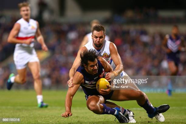 Matthew Suckling of the Bulldogs tackles Brady Grey of the Dockers during the round three AFL match between the Fremantle Dockers and the Western...
