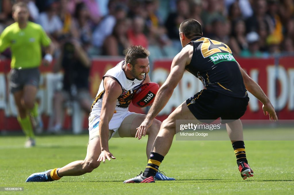Matthew Suckling of the Hawthorn Hawks sustains a right leg injury when trying to run past Troy Chaplin of the Richmond Tigers during the round three NAB Cup AFL match between the Hawthorn Hawks and the Richmond Tigers at Aurora Stadium on March 9, 2013 in Launceston, Australia.