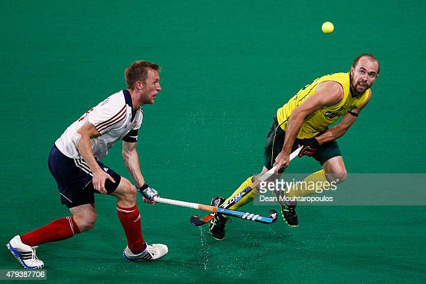 Matthew Swann of Australia battles for the ball with Barry Middleton of Great Britain during the Fintro Hockey World League SemiFinal match between...