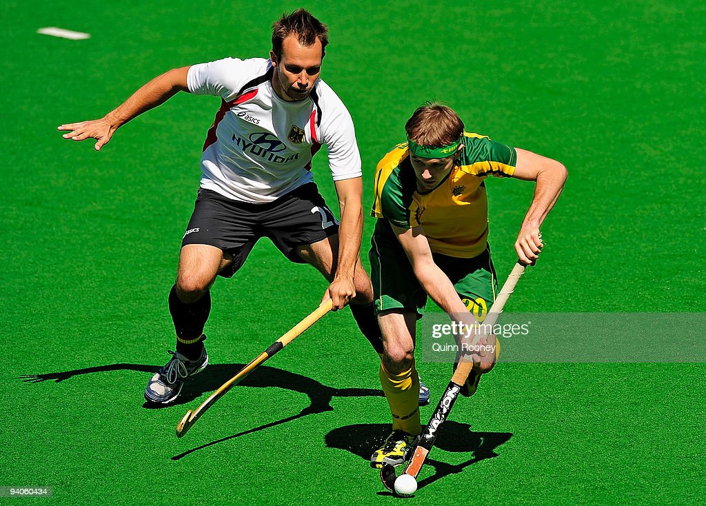 Matthew Swann of Australia gets past Matthias Witthaus of Germany in the 2009 Hockey Champions Trophy 1st/2nd place playoff match between Australia...