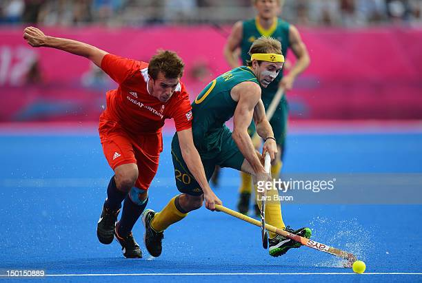 Matthew Swann of Australia is challenged by Matthew Daly of Great Britain during the Men's Hockey bronze medal match on Day 15 of the London 2012...