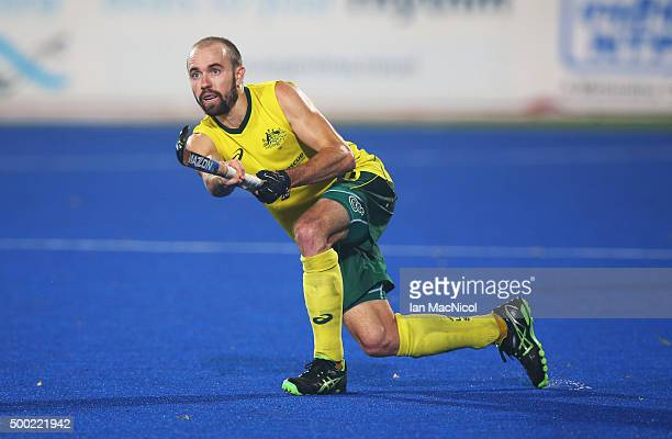 Matthew Swann of Australia plays a shot during the final match between Australia and Belgium on day ten of The Hero Hockey League World Final at the...