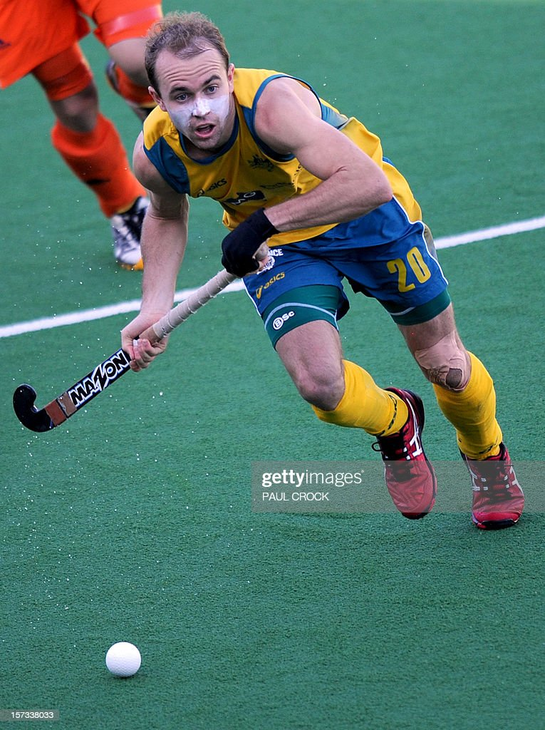 Matthew Swann of Australia takes a run down the pitch during their Pool B match against the Netherlands at the Men's Hockey Champioships Trophy in Melbourne on December 2, 2012. IMAGE STRICTLY RESTRICTED TO EDITORIAL USE - STRICTLY NO COMMERCIAL USE AFP PHOTO/Paul CROCK
