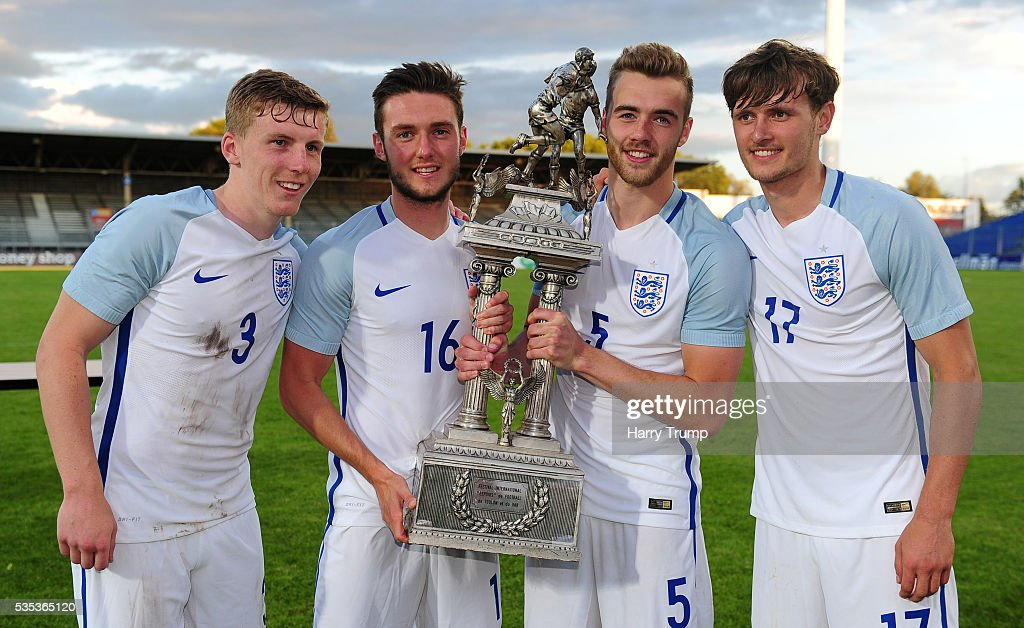 Matthew Targett, Matthew Grimes, Calum Chambers and John Swift of England pose with the trophy during the Final of the Toulon Tournament between England and France at Parc Des Sports on May 29, 2016 in Avignon, France.