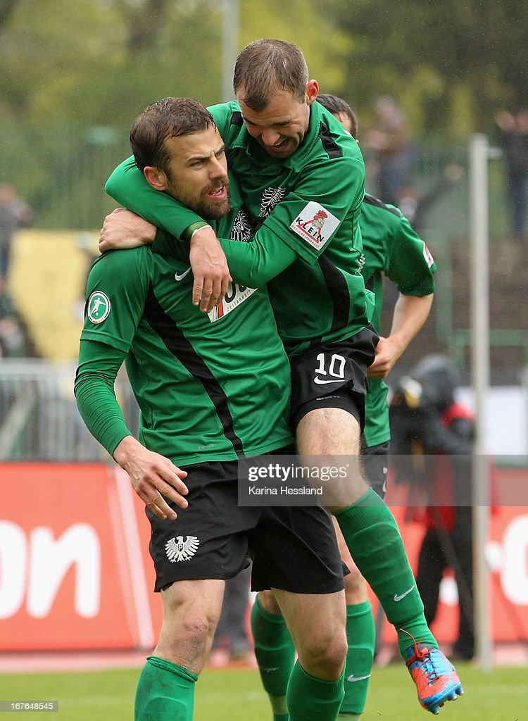 Matthew Taylor and Amaury Bischoff of Muenster celebrate the goal to 1:1 of Matthew Taylor during the 3rd Liga match between RW Erfurt and Preussen Muenster at Steigerwald Stadion on April 27, 2013 in Erfurt, Germany. (Photo by Karina Hessland/Bongarts/Getty Images) at Steigerwald Stadion on April 27, 2013 in Erfurt, Germany.