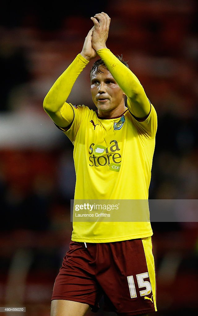 Matthew Taylor of Burnley applauds the fans during the Sky Bet Championship match between Nottingham Forest and Burnley at City Ground on October 20, 2015 in Nottingham, England.