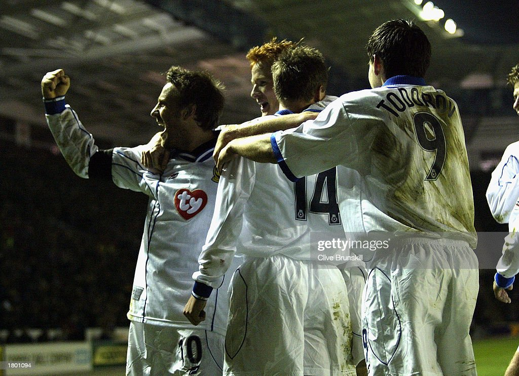 Matthew Taylor of Portsmouth celebrates with his team mates during the Nationwide League Division One match between Leicester City and Portsmouth at Walkers Stadium, Leicester, England on February 17, 2003.