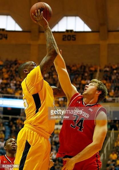 Matthew Temple of the Texas Tech Red Raiders gets a hand on the ball against Elijah Macon of the West Virginia Mountaineers at the WVU Coliseum on...