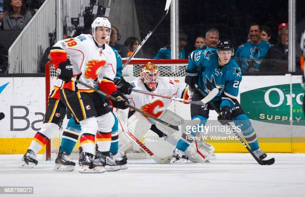 Matthew Tkachuk and Brian Elliott of the Calgary Flames defend the net against Marcus Sorensen of the San Jose Sharks at SAP Center on April 8 2017...