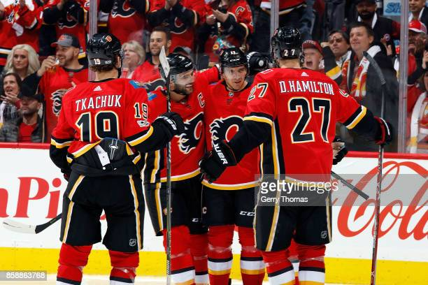 Matthew Tkachuk Mark Giordano Mikael Bcklund and Dougie Hamilton of the Calgary Flames skates against X #xx of the Winnipeg Jets during an NHL game...