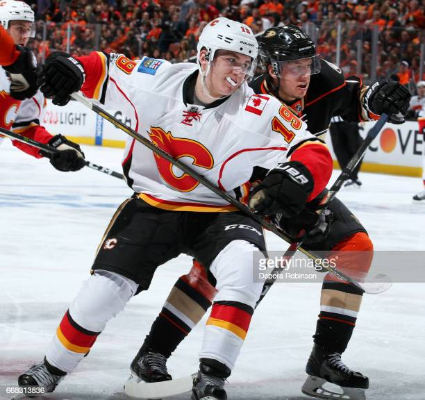 Matthew Tkachuk of the Calgary Flames battles for position against Rickard Rakell of the Anaheim Ducks in Game One of the Western Conference First...
