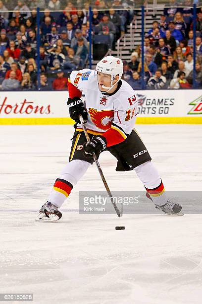 Matthew Tkachuk of the Calgary Flames controls the puck during the game against the Columbus Blue Jackets on November 23 2016 at Nationwide Arena in...