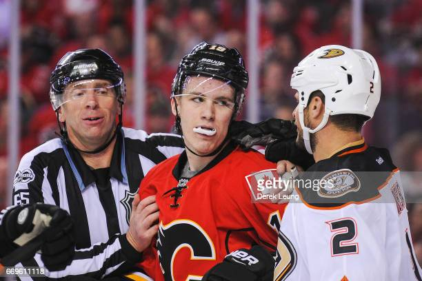 Matthew Tkachuk of the Calgary Flames exchanges words with Kevin Bieksa of the Anaheim Ducks after the whistle in Game Three of the Western...
