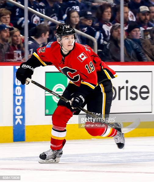 Matthew Tkachuk of the Calgary Flames follows the play down the ice during first period action against the Winnipeg Jets at the MTS Centre on January...