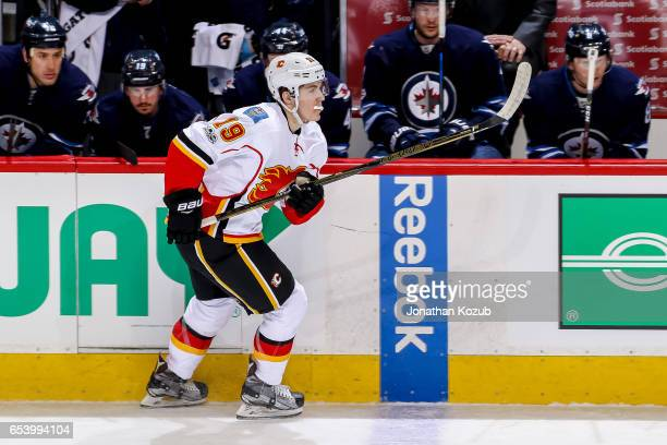 Matthew Tkachuk of the Calgary Flames follows the play down the ice during first period action against the Winnipeg Jets at the MTS Centre on March...