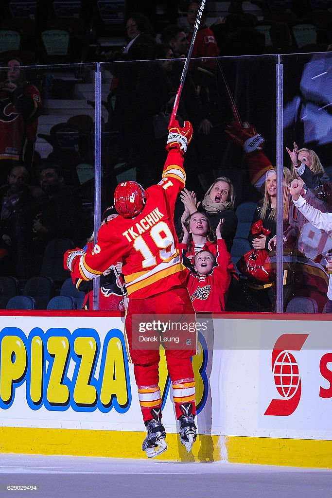 Matthew Tkachuk #19 of the Calgary Flames gives a stick to a fan after earning the third star of the night following a victory over the Winnipeg Jets during an NHL game at Scotiabank Saddledome on December 10, 2016 in Calgary, Alberta, Canada.