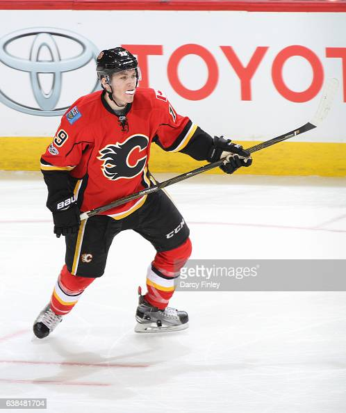 Matthew Tkachuk of the Calgary Flames keeps an eye on the play during second period action against the Winnipeg Jets at the MTS Centre on January 9...