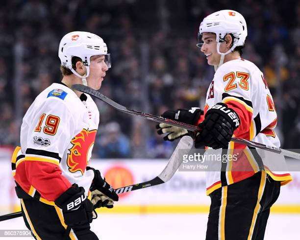 Matthew Tkachuk of the Calgary Flames reacts to his goal with Sean Monahan to tie the game 32 with the Los Angeles Kings during the third period in a...