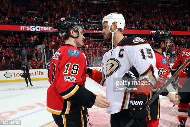 Matthew Tkachuk of the Calgary Flames shakes hands with Ryan Getzlaf of the Anaheim Ducks after Game Four of the Western Conference First Round...