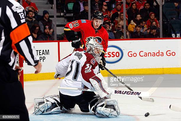 Matthew Tkachuk of the Calgary Flames shoots the puck against Calvin Pickard of the Colorado Avalanche during an NHL game on January 4 2017 at the...
