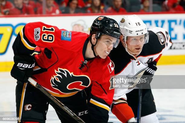 Matthew Tkachuk of the Calgary Flames skates against Corey Perry of the Anaheim Ducks during Game One of the Western Conference First Round during...
