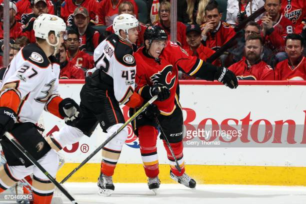 Matthew Tkachuk of the Calgary Flames skates against Josh Manson of the Anaheim Ducks during Game Four of the Western Conference First Round during...