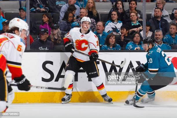Matthew Tkachuk of the Calgary Flames skates against Marcus Sorensen of the San Jose Sharks at SAP Center on April 8 2017 in San Jose California