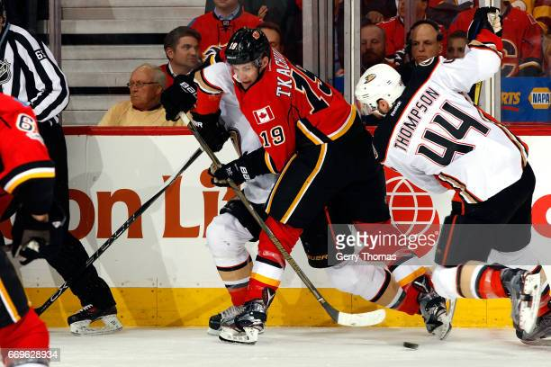 Matthew Tkachuk of the Calgary Flames skates against Nate Thompson of the Anaheim Ducks during Game One of the Western Conference First Round during...