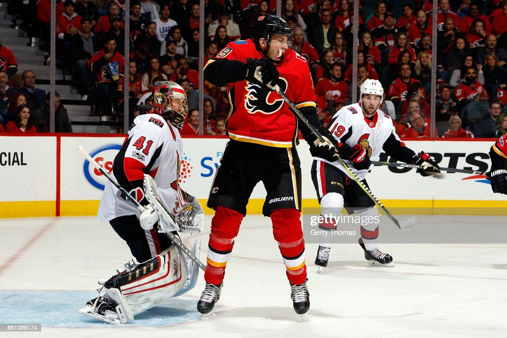 Matthew Tkachuk #19 of the Calgary Flames skates in front of Craig Anderson #41 of the Ottawa Senators during an NHL game on October 13, 2017 at the Scotiabank Saddledome in Calgary, Alberta, Canada.