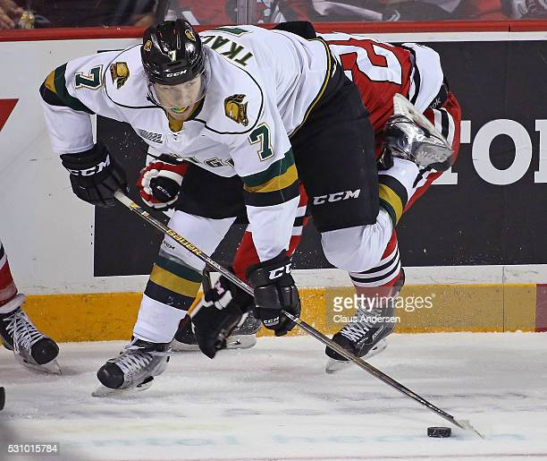 Matthew Tkachuk of the London Knights gains control of the puck against Aaron Haydon of the Niagara IceDogs during Game Four of the OHL Championship...