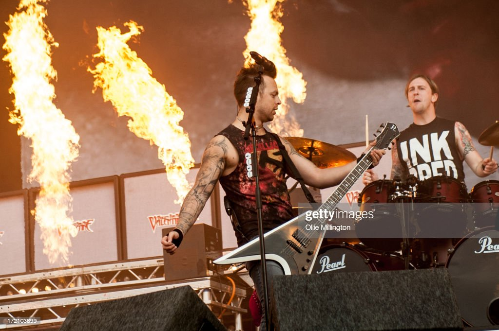 Matthew Tuck and Michael Moose Thomas of Bullet For My Valentine perform at Day 1 of The Download Festival at Donnington Park on June 14, 2013 in Donnington, England.