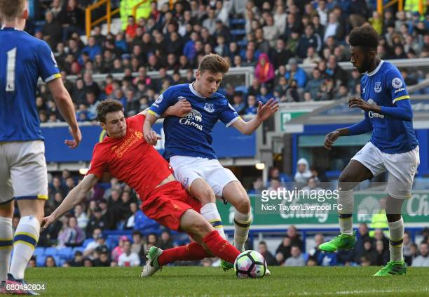 Matthew Virtue of Liverpool and Joe Williams and Beni Baningime of Everton in action during the Everton v Liverpool Premier League 2 game at Goodison...