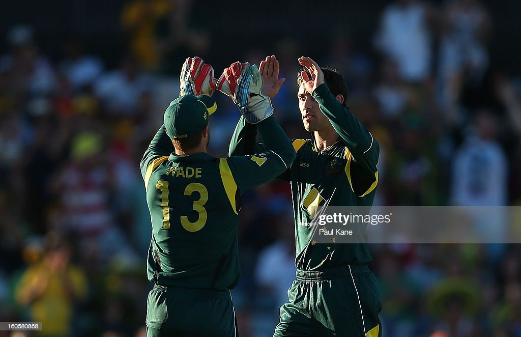 Matthew Wade and Glenn Maxwell of Australia celebrate the run out of Jason Holder of the West Indies to win game two of the Commonwealth Bank One Day International Series between Australia and the West Indies at WACA on February 3, 2013 in Perth, Australia.
