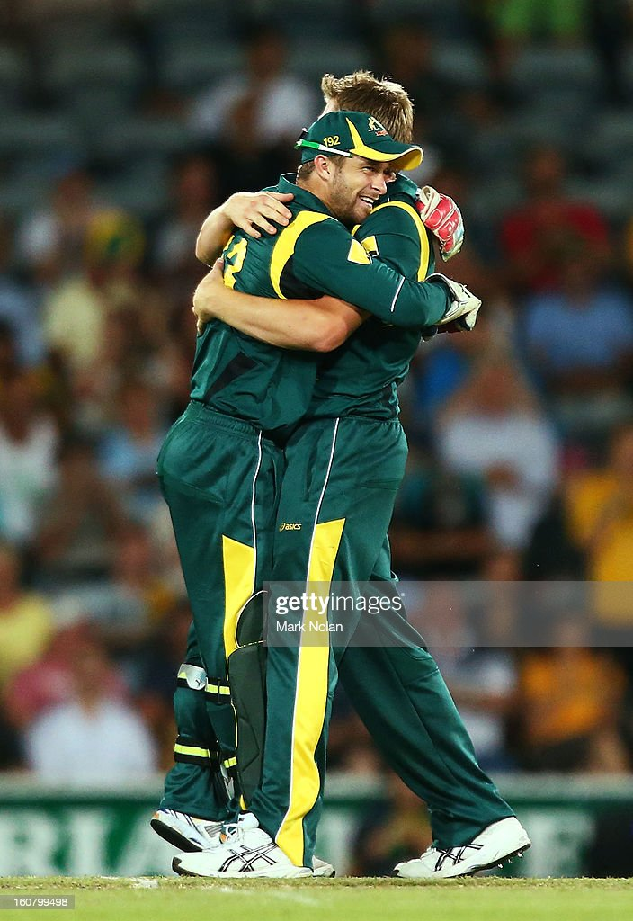 Matthew Wade and James Faulkner of Australia celebrate the wicket of Darren Sammy of the West Indies during the Commonwealth Bank One Day International Series between Australia and the West Indies at Manuka Oval on February 6, 2013 in Canberra, Australia.