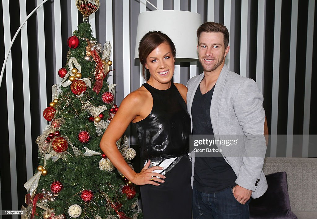<a gi-track='captionPersonalityLinkClicked' href=/galleries/search?phrase=Matthew+Wade&family=editorial&specificpeople=724041 ng-click='$event.stopPropagation()'>Matthew Wade</a> and Julia Barry pose next to a Christmas tree ahead of a Cricket Australia Christmas Day lunch at Crown Entertainment Complex on December 25, 2012 in Melbourne, Australia.